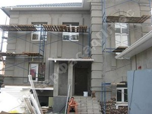 Покраска стен фасада дома