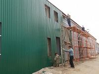 Обшивка здания металлопрофилем
